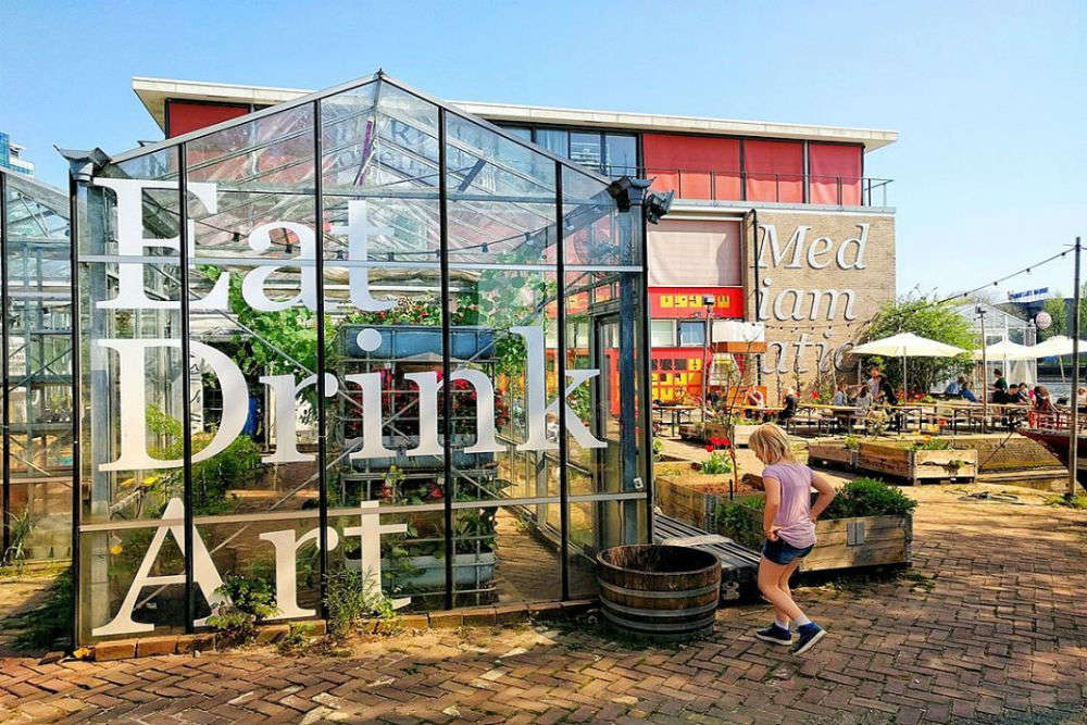 Amsterdam restaurant takes social distancing to another level by serving food in private greenhouses