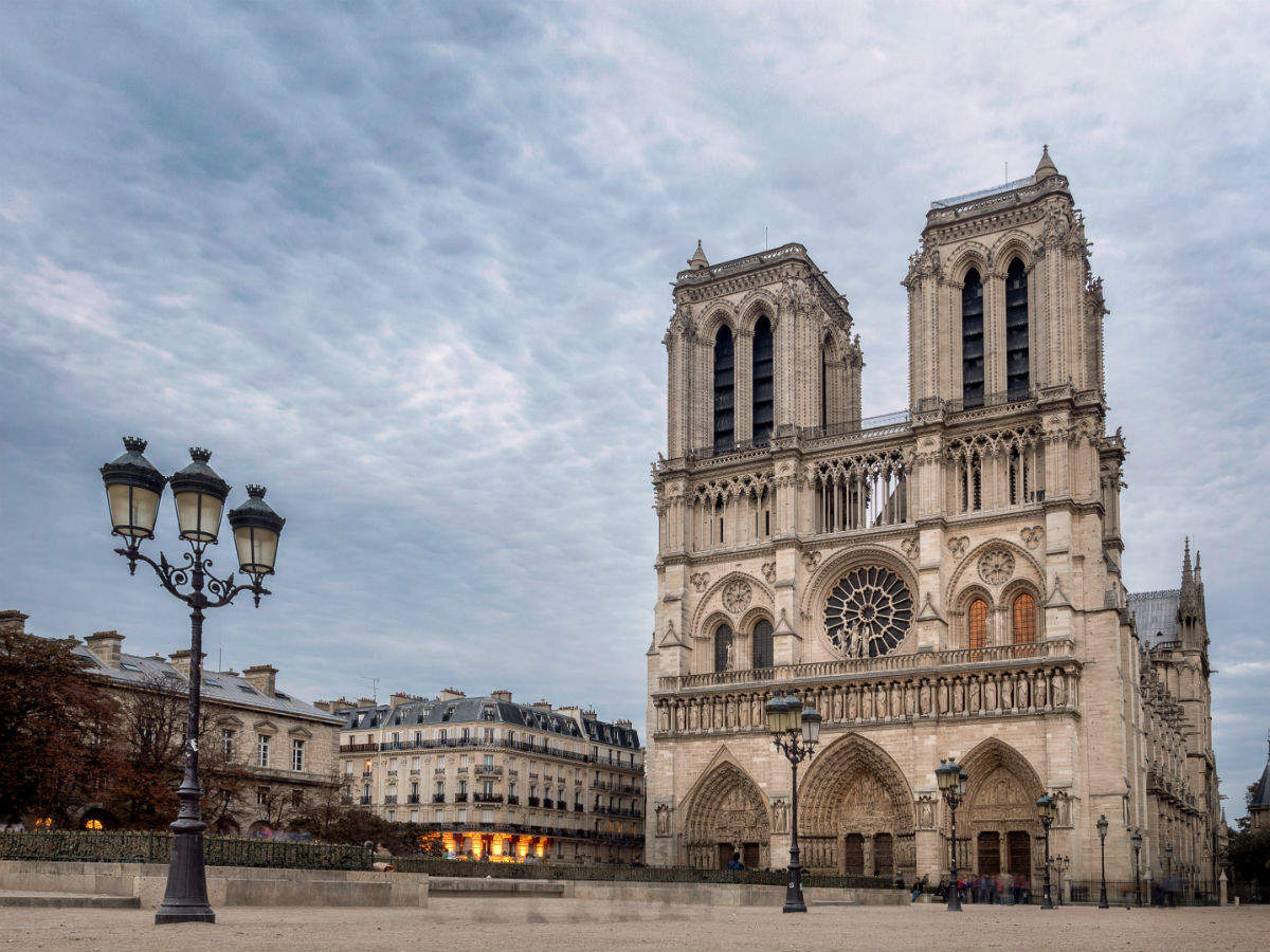 Carpenters in Paris mesmerise public by reenacting the making of original Notre Dame building