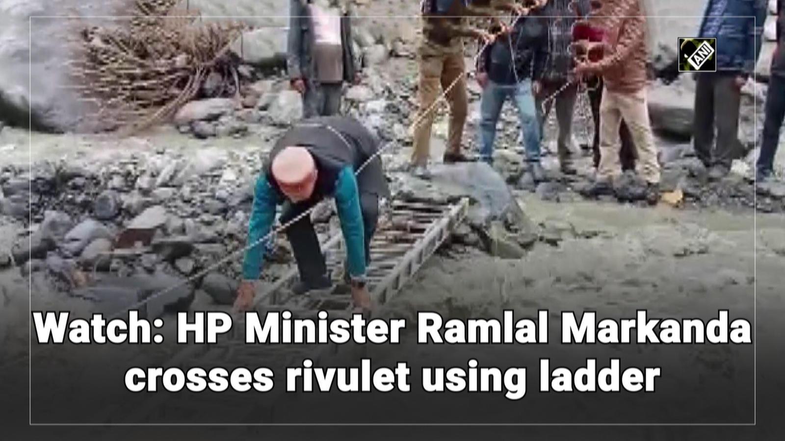 watch-hp-minister-ramlal-markanda-crosses-rivulet-using-ladder