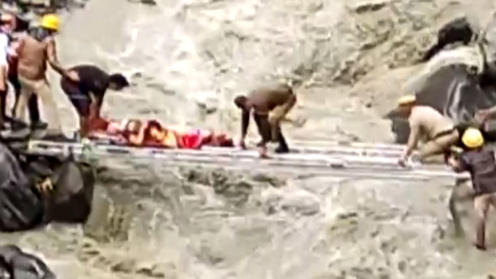 hp-rescue-team-carries-injured-person-across-raging-stream-using-ladders-as-bridge