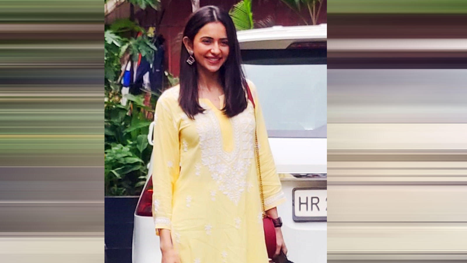 rakul-preet-singh-opts-for-a-bright-yellow-outfit-for-her-work-outing