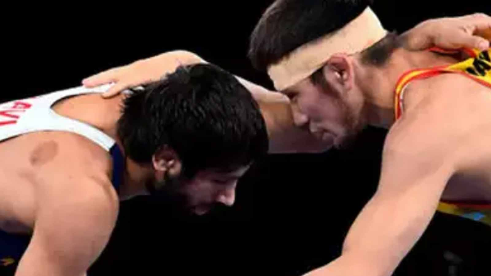 ravi-dahiya-pins-sanayev-to-storm-into-olympic-final-assured-of-at-least-a-silver-medal