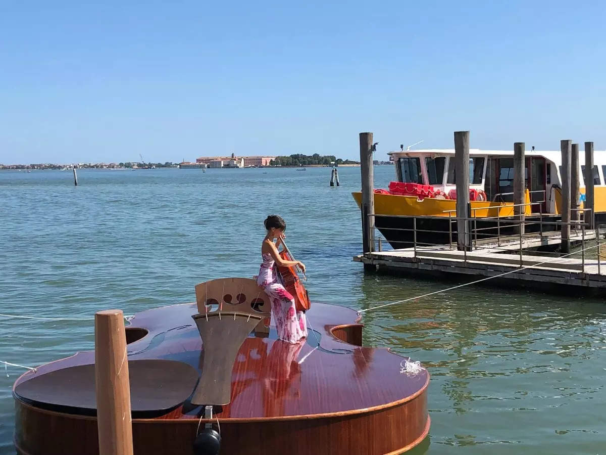 You have to see this beautiful, giant violin-shaped boat in the canals of Venice!