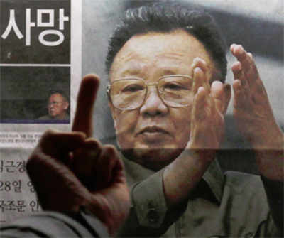 Us lawmaker wishes kim in hell with hitler stalin bangalore mirror a man reacts at a picture of north korean leader kim jong ii as he reads the reports of his death on the newspaper companys display board in seoul reuters thecheapjerseys Choice Image