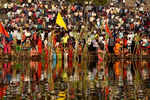 Devotees hailing from Bihar, Jharkhand and parts of UP perform Chhath Puja on bank of River Tapi in Gujarat's Singanpore area.