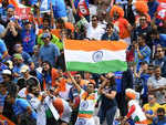 Indian supporter waves a flag