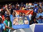 Fans with Virat Kohli banner