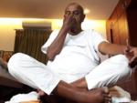 Ex-PM Deve Gowda practices Yogasanas