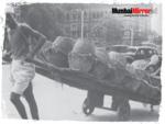 Man carrying a hand cart