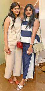 Beige not boring! Shikha opts for a monochromatic outfit that she has paired with a peppy red sling bag and pale orange flats and Stripe it up! Snigdha chooses to go bold with her navy blue flared pants and  broad-striped  high-collared top