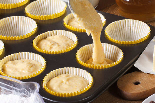 pouring-cake-batter-in-muffin-cup