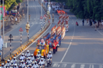 Cops participate in a colourful road show in Ahmedabad