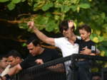 SRK and Abram wave to the crowds