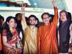 Uddhav Thackeray with son Aaditya and wife Rashmi after taking oath