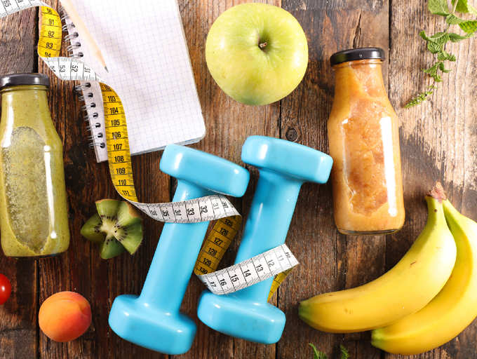 different items to help prevent or control hypertension - banana, fruit juice, hand weight, an apple, a journal and a tape measure