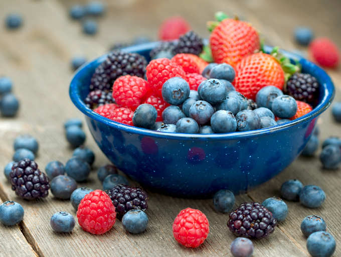 a bowl of various berries that are good for hypertension and high blood pressure