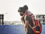 Migrants walk home