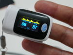 How does pulse oximeter help in diagnosing COVID pneumonia