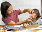 Decorate the face covers or masks with your kids