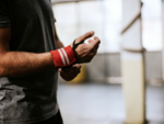 ​Wear gym gloves and arm sweatbands while working out
