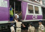 Security personnel help passengers