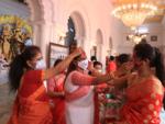 Sindur Khela with masks on