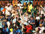 Fans enjoy a game of cricket