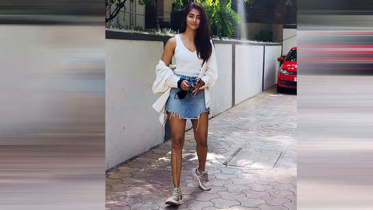 Pooja Hegde poses for paparazzi outside her home in Mumbai