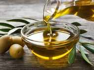 Why is olive oil not suitable for Indian cooking?