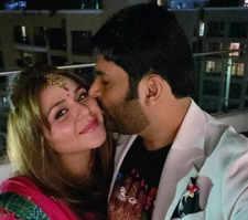 Kapil Sharma plants a kiss on Ginni Chatrath's cheek