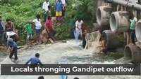 Locals in Hyderabad catch fishes in the Gandipet outflow