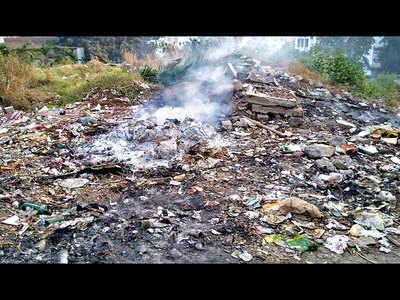 Ambegaon Budruk residents irked as staffers of Sinhgad college burn trash