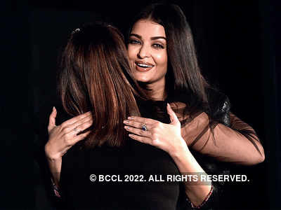 Aishwarya Rai Bachchan hugs a fan at a film launch