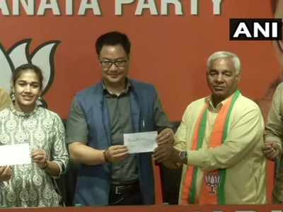 Wrestler Babita Phogat, father Mahavir join BJP; Kiren Rijiju says their induction will help party in poll-bound Haryana
