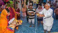 CM Nitish Kumar offers 'Arghya' to rising sun during Chhath Puja in Patna