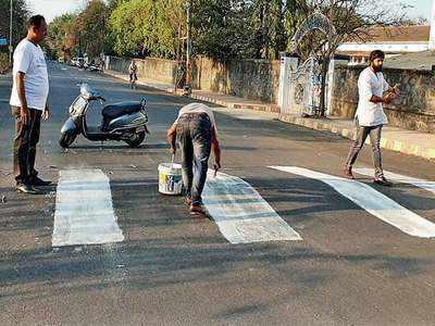 Locals paint bumpy street
