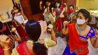 Maharashtra: Women with their masks on perform garba privately at a home in Pune