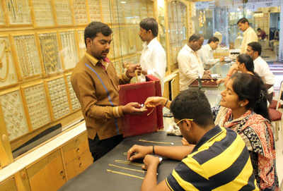 Gold weakens on muted demand, global cues