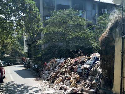 Discarded debris blocks road in Mazgaon