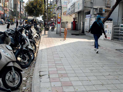 In HSR Layout, Palike is riding cycles to clean drains