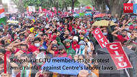 Bengaluru: CITU members stage protest amid rainfall against Centre's labour laws