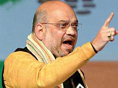 Amit Shah taunts Rahul, dares him to debate with BJP youth wing chief