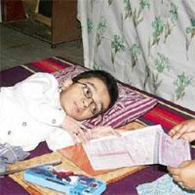 With brittle bones and steely grit, 18-year-old writes exam lying down