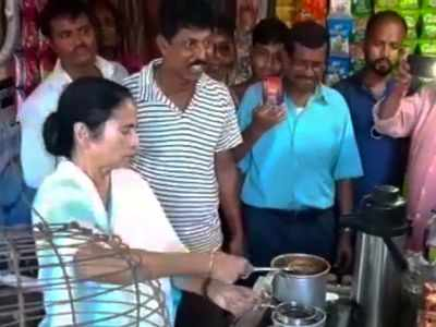 West Bengal Chief Minister Mamata Banerjee makes tea at a tea shop, serves locals