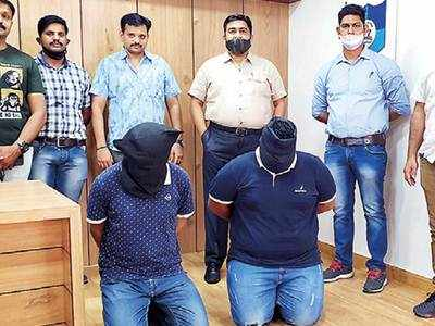 Two IT employees held for extortion attempt