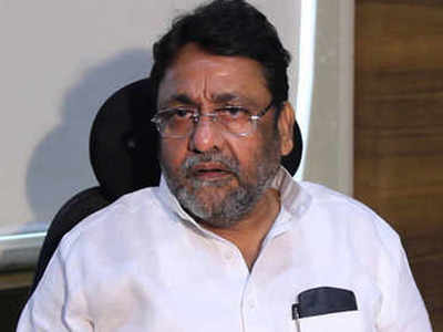 Won't remove PM Modi's photo from certificates, let Maharashtra make its own vaccine app: Nawab Malik