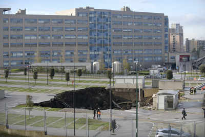 Giant sinkhole consumes cars in Naples hospital parking lot