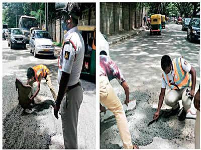 Cops fix the dangerous roads of Jalahalli