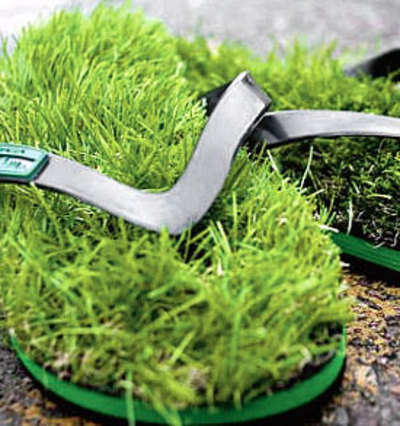 6d3f93efb966 Flip flops with fake grass for that barefoot feeling