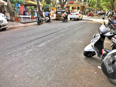 Where's the parking on Dhole Patil Road?
